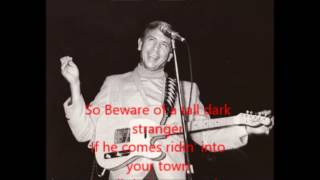 Tall Dark Stranger Buck Owens with Lyrics.
