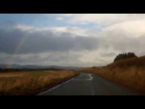 Winter Driving Towards Rainbow Strathearn Perthshire Scotland