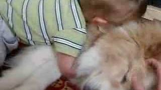snuggle boy meets dog