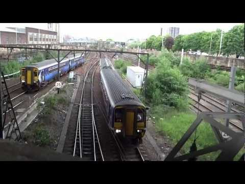2 outbound trains diverting  from the main rail corridor from Scotland Glasgow Central Terminal