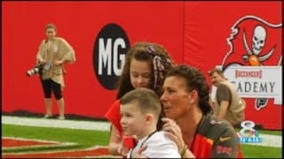Sailor surprises kids during Tampa Bucs game