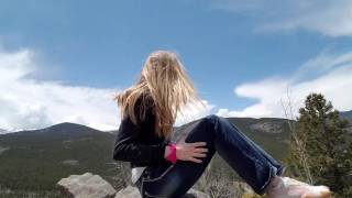 Yoga on the top of a mountain