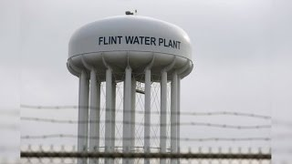 Justice or Sham? 6 State Employees Charged in Flint Water Disaster