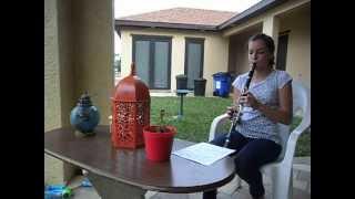 Ashley Nicole playing the clarinet