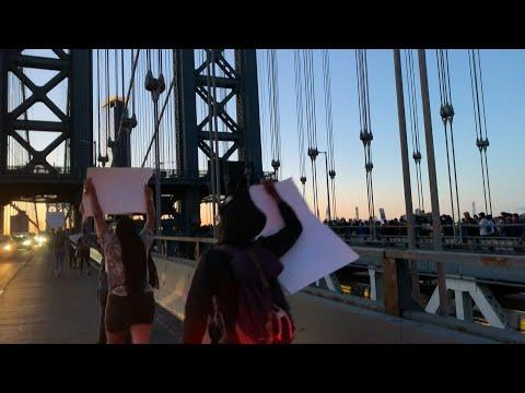 Anti-racism protestors cross Manhattan Bridge in New York | AFP