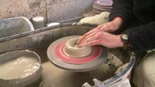 Making throwing a few different simple clay pottery ash trays / plates / dishes / on the wheel