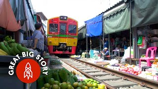 Watch a Train Run Through Thailand's Most Dangerous Market width=