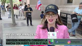 Univision Minnesota attends the march in St. Paul for Puerto Rico