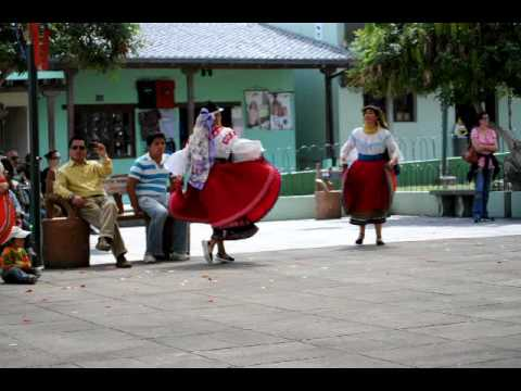 Ecuadorian folkloric dancers in the middle of the world