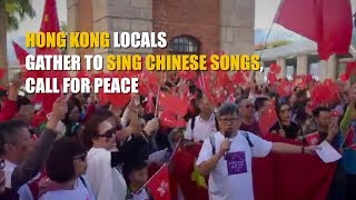 Hong Kong locals gather to sing Chinese songs, call for peace