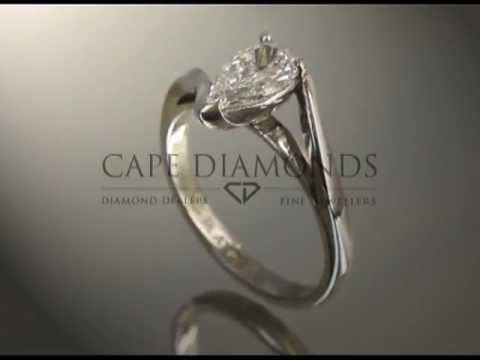 Solitaire ring,pear diamond,twist in band,platinum,engagement ring