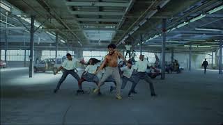 Childish Gambino doing the 'Gwara Gwara' African dance move in his new video