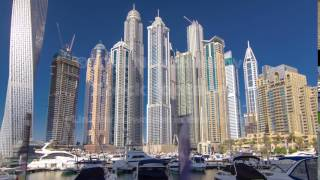 Dubai Marina with skyscrapers and boats Hyperlapse