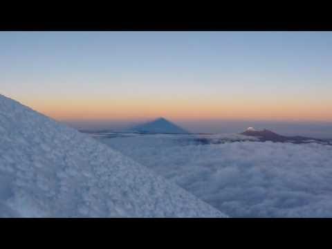 Cotopaxi summit, sunrise shadow.