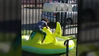 Boy rides on a pool dragon