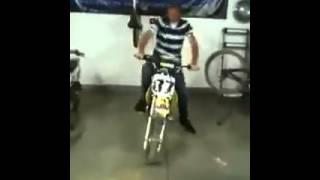 A man imitatitng motocross engine sound