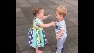 Cute baby couples kissing.