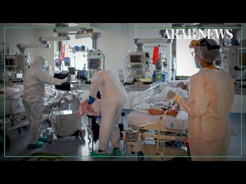 Madrid hospital faces surge in virus cases