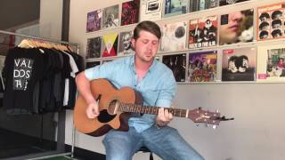 "Devin Burris performing ""One Second Longer"" inside Red Door Records in downtown Valdosta."