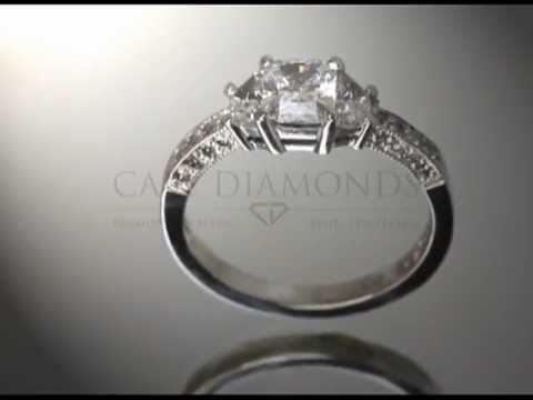 3 stone ring,cushion diamond,2 diamonds each side,small side stones,engagement ring