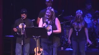 "Elaina Rusk singing ""Life is a Highway"" at the Media Music Jam"