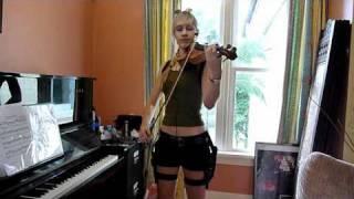Lara plays the Tomb Raider theme IN COSTUME
