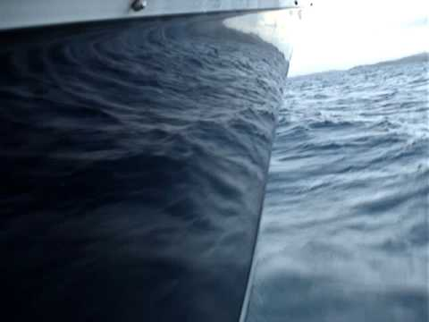 Speeding over the Coast of Puerto Rico on a Jupiter 39.5′ with 3 Mercury 300's Full Throttle