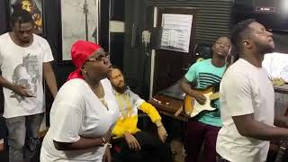 Teni in studio making music with phino