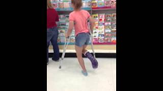 Little sister attempts a dance dare in target. With a broken leg.