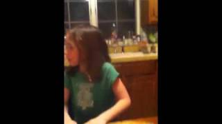 Girl stuffing peanuts in her mouth