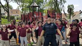 Wiggle Dance Cop having fun with kids at Horace Mann school
