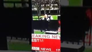Police officer stacks it over fence at Westminster live on BBC news