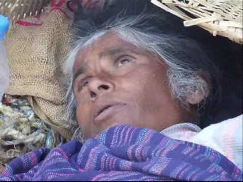 An older beggar is strubggling for survive near ex Royal Palace of Nepal