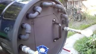 Wood fire hot water heater.