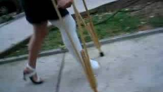 Girl in LLC and crutches