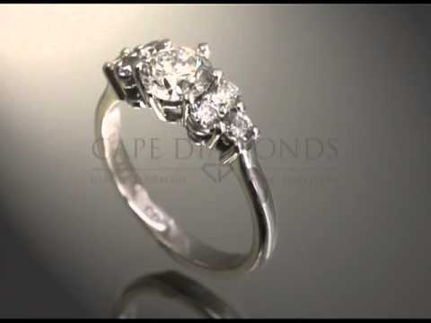 complex stone ring,round diamond,3small diamonds a side,polished platinum,engagement ring
