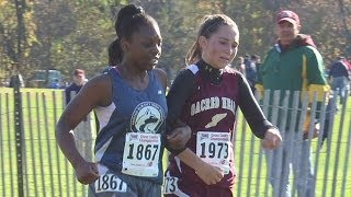 Cross country runner helps competitor finish race