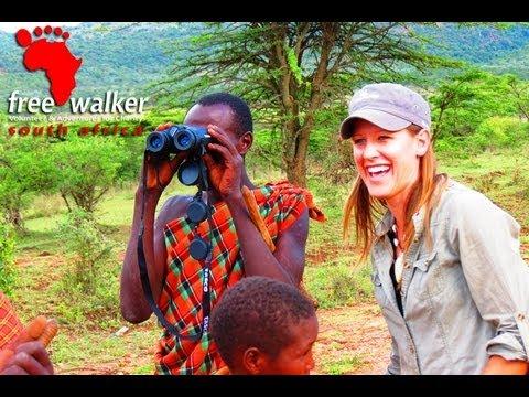 Maasai using binoculars for first time
