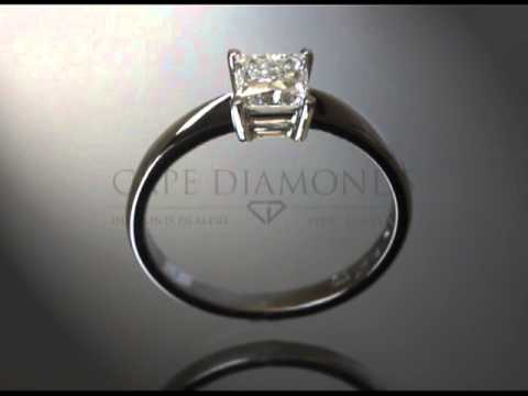 Princess cut,diamond,small baroque detail on side of stone,platinum,engagement ring