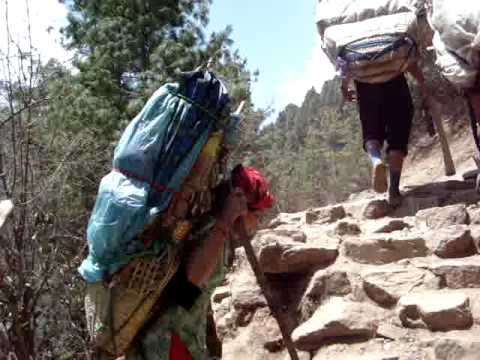 Sherpa porters trudge up to Namche for the bazaar