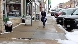 Girl crutching in the city with long leg cast part 2