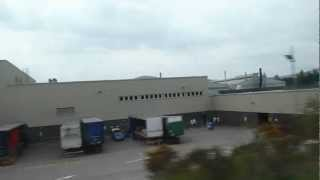 Former DeLorean factory from train