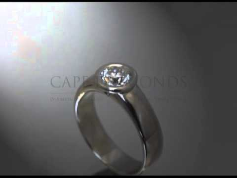 Solitaire ring,round diamond,round fitting,bold band,platinum,engagement ring