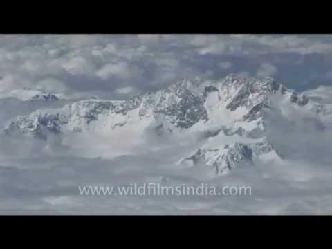 Kanchenjunga through clouds like ice cream, over the Himalaya…