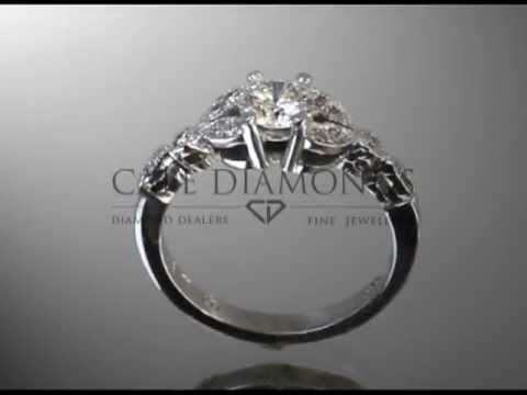 complex stone ring,round diamonds,pear shaped diamonds,different sizes,platinum,engagement ring