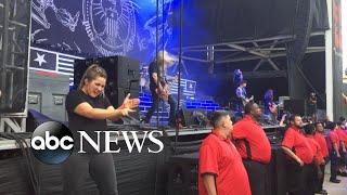 Sign language interpreter rocks out at heavy metal concert