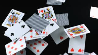 Playing Cards Falling Down in Slow Motion as Pack Decks Drop from Players HD Video Photography View