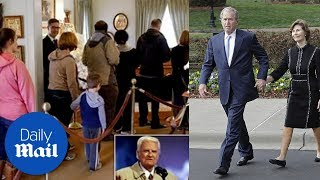 George W Bush and wife Laura pay their respects to Billy Graham - Daily Mail