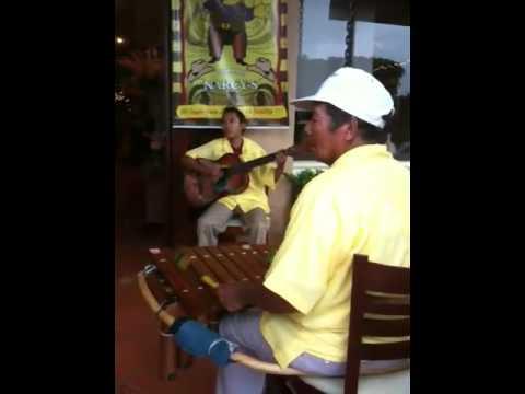 Nicaraguan music outside of Papa John's Pizza