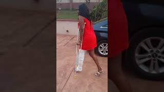 Sexy girl walking with crutches with broken leg on cast